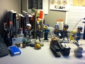 "A clean desk for 2014. A clean ""ice rink"" for my Sharks bobbleheads!"